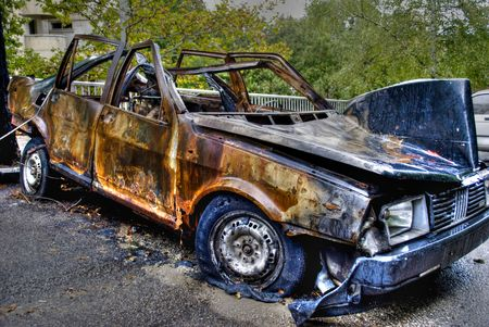 abandoned burnt rusted car - a terrorism act
