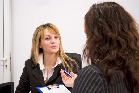 applicant: young woman being interviewed for a job Stock Photo