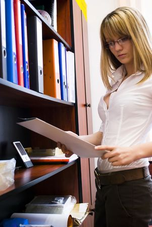 young and sexy secretary searching for documents