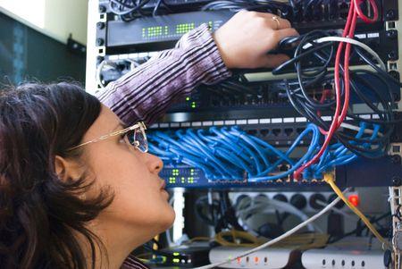 young woman repairs computer hardware