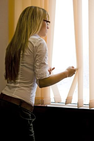 attractive woman looking out of window Stock Photo - 6506310