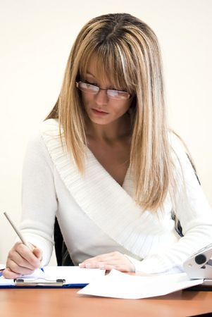 attractive woman working in the office Stock Photo - 6506322