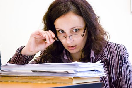 young businesswoman looking pile of documents over glasses Stock Photo - 6506320