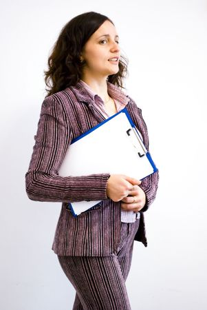 attractive businesswoman holding blank papers and going to a meeting Stock Photo - 6506329