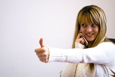 young businesswoman showing thumb up Stock Photo - 6506296