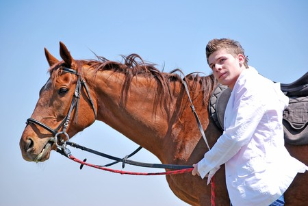 cowboy on horse: young and attractive man riding brown horse Stock Photo