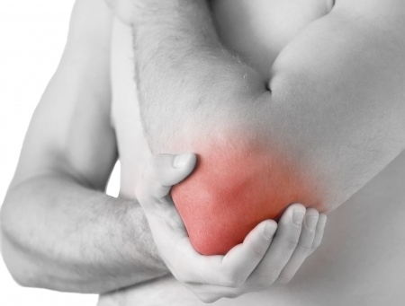 young man having pain in his elbow Stock Photo - 7496388