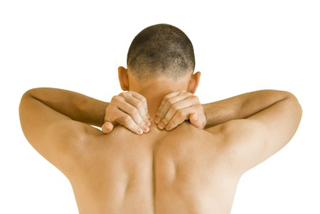 back strain: young man having neck ache making massage Stock Photo