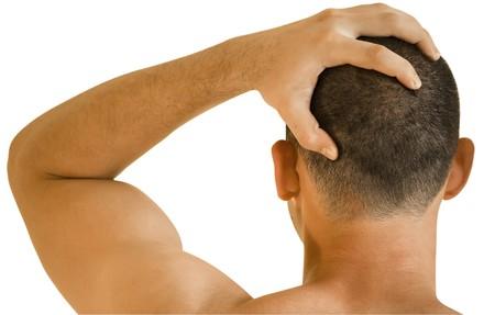 young man having headache making massage Stock Photo - 7496389