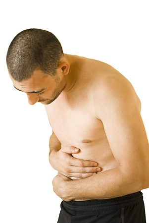 young man having pain in his stomach Stock Photo - 7496399