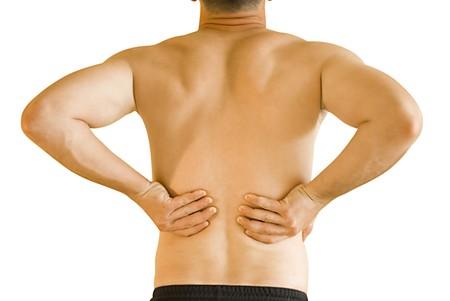 sports injury: backache Stock Photo