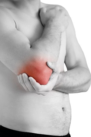 elbows: young man having pain in his elbow Stock Photo