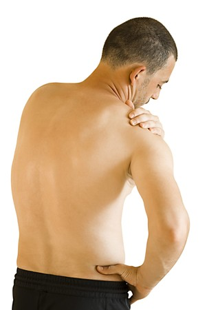 young man having neck and shoulder ache making massage photo