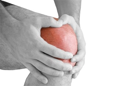 man having pain in his knee making massage Stock Photo