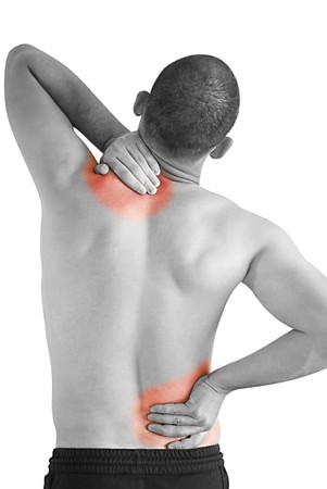 back strain: young man having neck ache and backache making massage