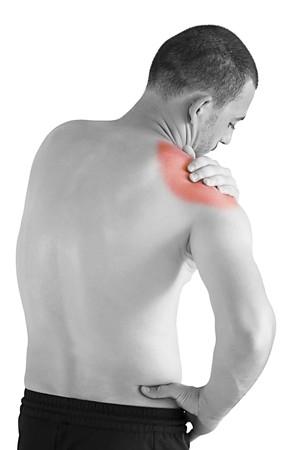 huesos: hombre joven tener masaje haciendo de dolor de cuello y hombro  Foto de archivo