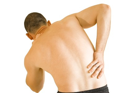 young man having neck ache and backache making massage
