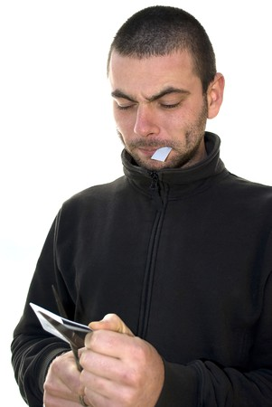 handsome young man cutting his credit card isolated photo