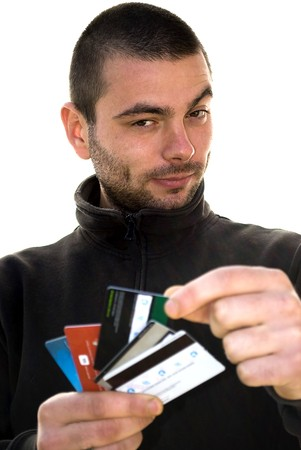 handsome young man holding credit cards isolated photo