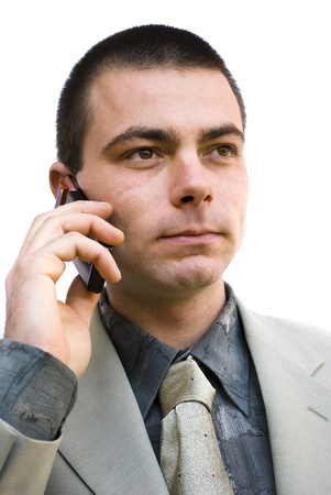 young handsome man talking on his mobile phone photo