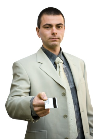 young business man with credit card looking up photo