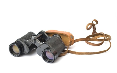 old binoculars with case isolated on white photo