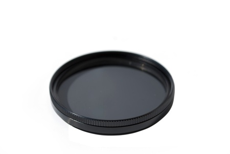 cir: camera lens filter isolated on white background