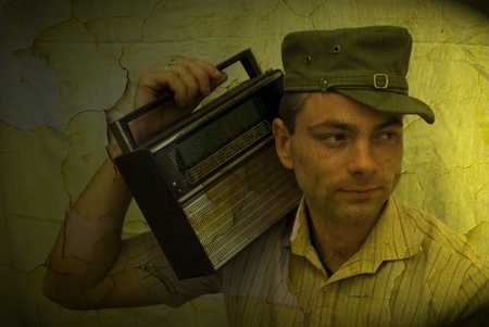 retro man listening to old radio on vintage background photo