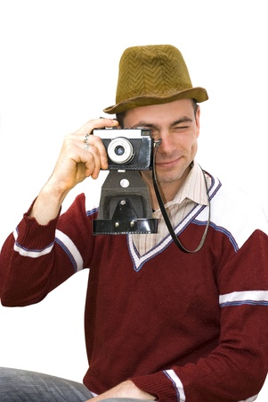 vintage photographer taking pictures isolated on white photo