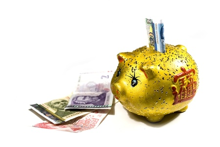 yellow piggy bank with money isolated on white photo