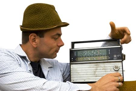 retro man listening to old radio isolated on white photo