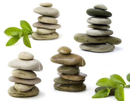 spirituality therapy: balanced spa stones with green plant isolated on white background Stock Photo