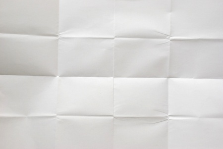 white sheet of paper folded into 16 pieces