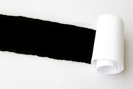 copyspace: torn white sheet of paper with black background and copyspace