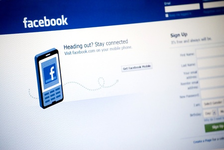 web scam: Facebook Logo and sign up page on a laptop screen, Facebook, worlds largest social networking site based in Palo Alto, CA, photo taken on June 8th, 2011, Bulgaria Editorial