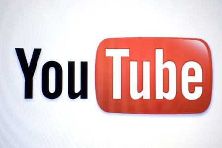 web scam: youtube Logo on a laptop screen Editorial