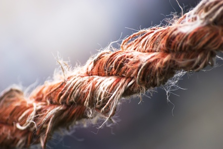 close up image: close up image of an used stretched rope
