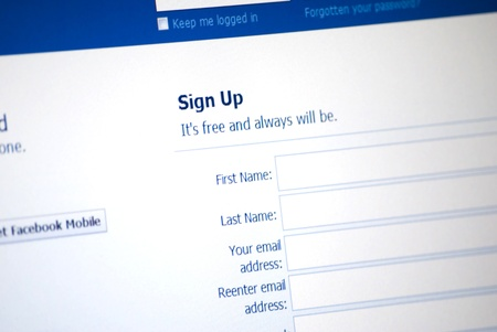 Facebook Logo and sign up page on a laptop screen Stock Photo - 9754347