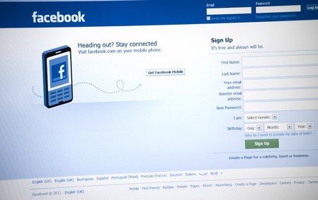 Facebook Logo and sign up page on a laptop screen