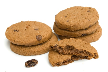 biscuits: pile of chocolate cookies isolated on white background