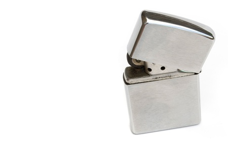 silver lighter isolated on white background photo