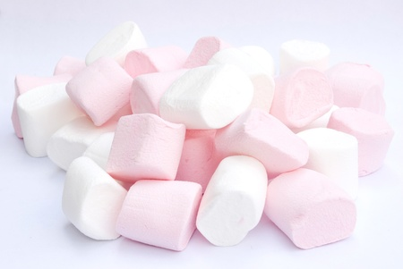 white and pink fluffy candies on gray background
