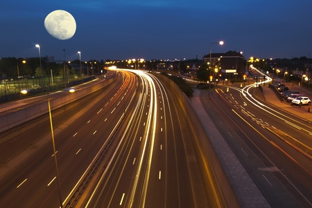 London traffic lights at night above a bridge