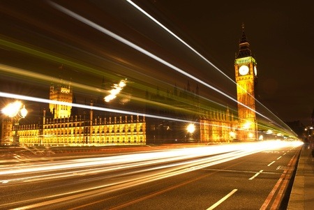 Big Ben and Parliament at night with trail lights photo