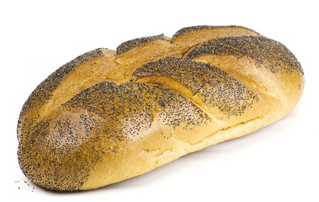 freshly baked loaf of bread covered with poppy seeds isolated on white background photo