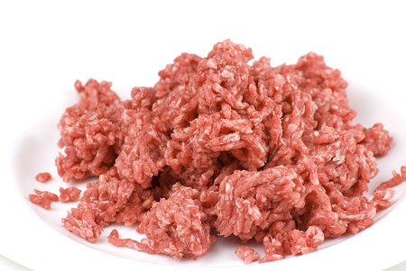 ground beef: pile of fresh raw beef mince in white plate