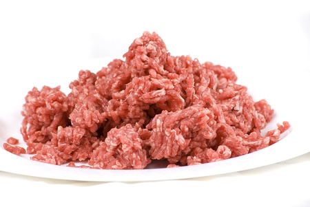 pile of fresh raw beef mince in white plate photo