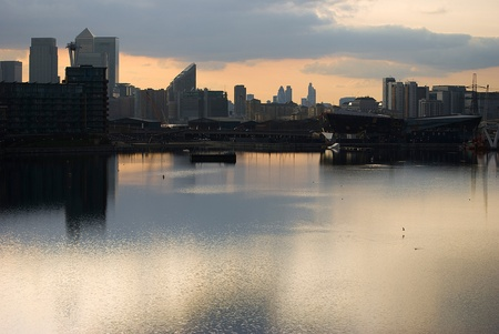 canary wharf silhouette over canal at sunset photo