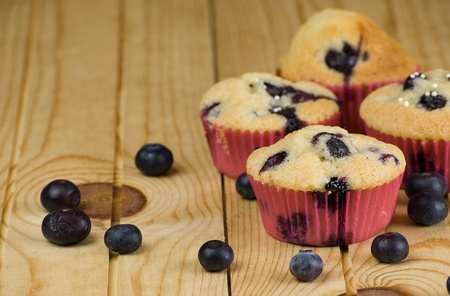 homemade blueberries muffins over wooden background Stock Photo - 12989753