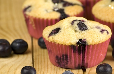 homemade blueberries muffins over wooden background photo